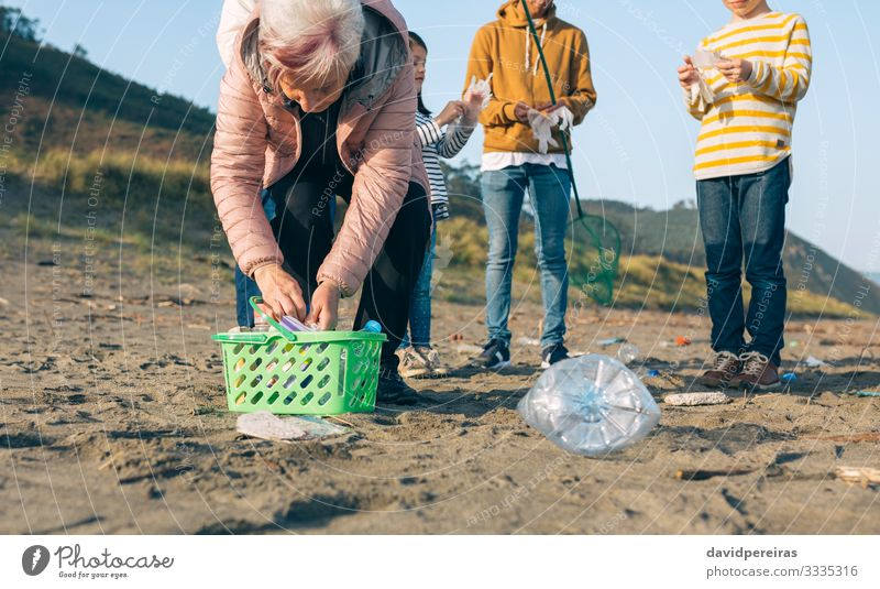 Volunteers preparing to clean the beach Beach Child Human being Boy (child) Woman Adults Man Family & Relations Group Environment Sand Gloves Old Dirty Clean