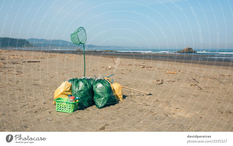 Garbage bags and utensils on the beach Beach Ocean Environment Nature Landscape Sand Coast Clean Disaster Teamwork garbage bags after volunteering