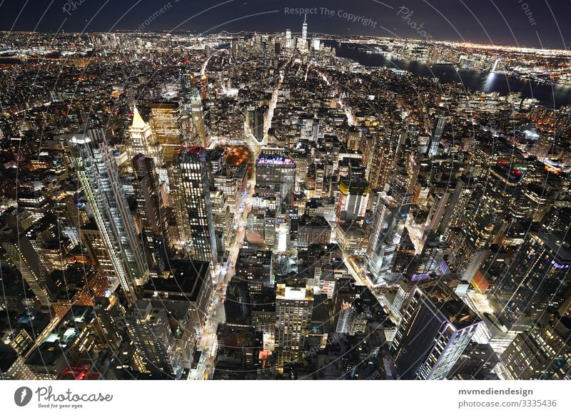 New York City at Night Street gorge of houses Night shot clearer Traffic infrastructure urban Empire State building top of the rock