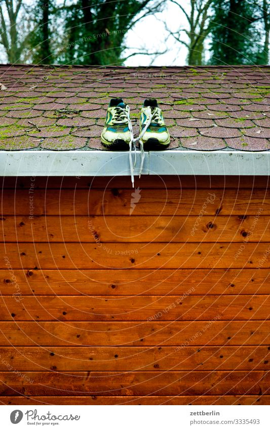 Shoes on the roof Footwear Sneakers In pairs Roof Gardenhouse House (Residential Structure) Hut Scales Storage shed Wooden house Trip Berlin Brandenburg Village