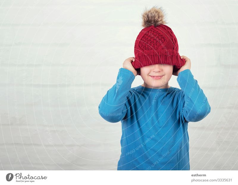 funny child with winter hat Lifestyle Joy Leisure and hobbies Winter Human being Masculine Child Toddler Infancy 1 8 - 13 years Weather Hat To hold on Smiling