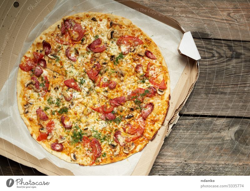 baked round pizza with smoked sausages Meat Sausage Cheese Vegetable Dough Baked goods Lunch Dinner Fast food Table Restaurant Packaging Package Wood Fresh Hot