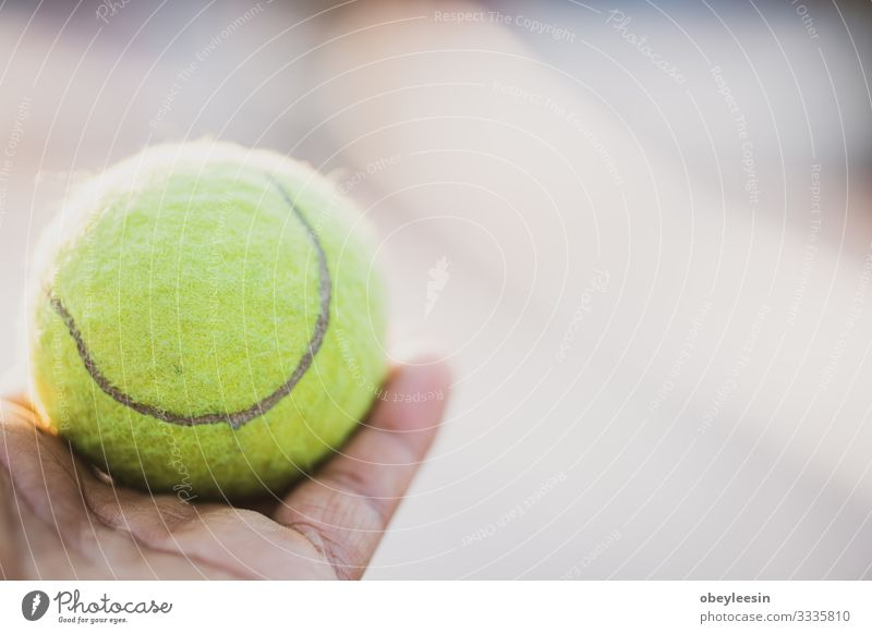 yellow tennis ball being held out in the light Lifestyle Style Design Freedom Sports Ball Art Stand Colour photo
