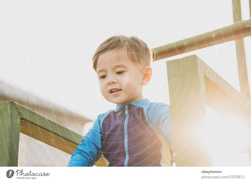 cute young mixed race boy smiling in the sun Lifestyle Happy Leisure and hobbies Playing Sports Child Human being Boy (child) Man Adults Family & Relations