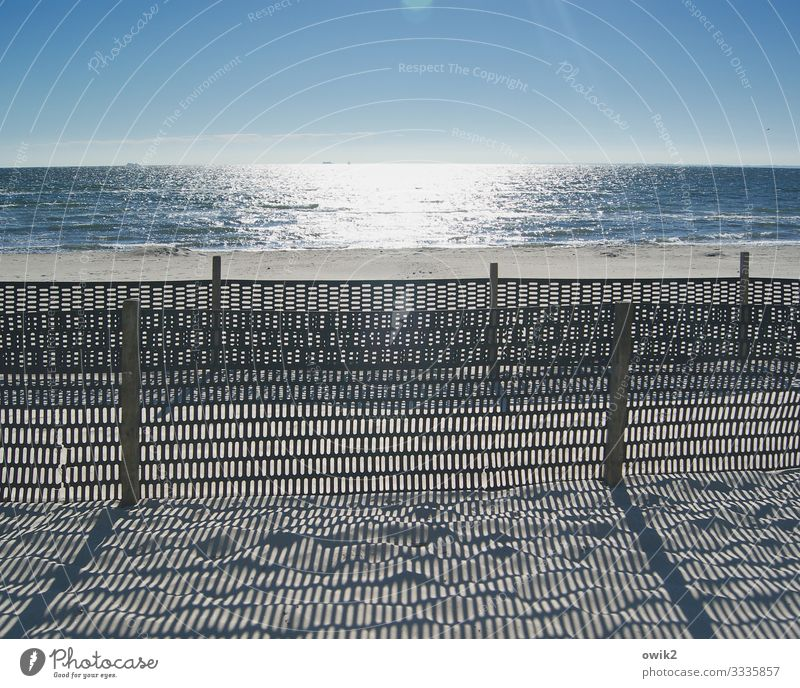 restricted area Environment Landscape Sand Water Cloudless sky Horizon Beautiful weather Coast Beach Baltic Sea Fence Fence post Barrier Boundary Wood Plastic