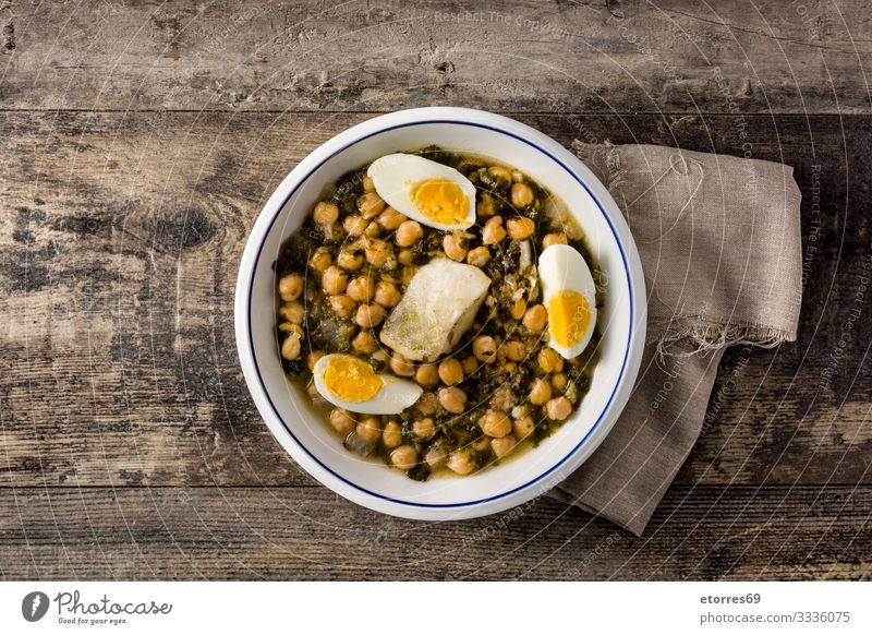 Chickpea stew with spinach and cod or potaje de vigilia. Chickpeas Stew Spinach Cod Food Healthy Eating Food photograph Characteristic Spanish Tradition Easter