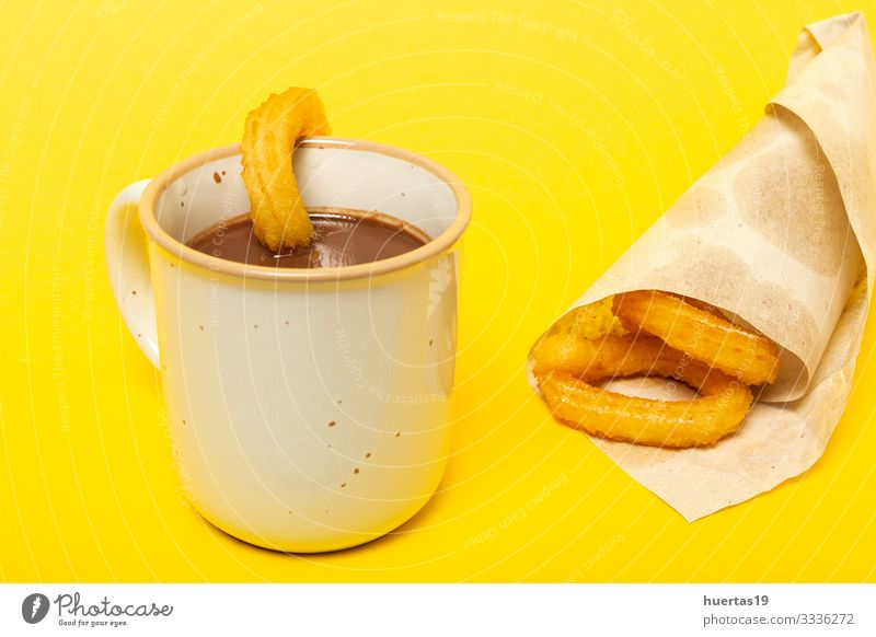 Cup of chocolate sauce with churros Food Dessert Breakfast Hot Chocolate Culture Yellow Tradition spanish Churros background cup Baked goods Frying Snack Spain
