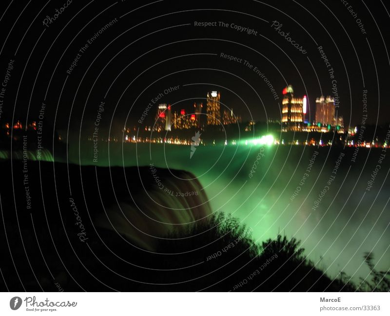 Water Lighting USA Exceptional Americas Canada Waterfall Famousness Tourist Attraction Night shot Play of colours Attraction Destination Niagara Falls (USA)