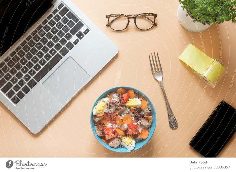 Desk table with computer, glasses and food in bowl Style Disciplined Tablet computer Computer Person wearing glasses Food Bowl Colour photo