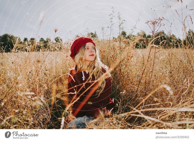 Young woman in a field in a sunny day calm tranquility silence nature portrait portraiture red blonde summer autumn backlight vintage warm comfort