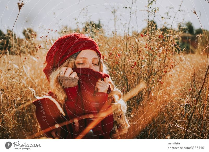 Young woman in a field in a sunny day Woman Human being Nature Youth (Young adults) Summer Landscape Red Calm 18 - 30 years Adults Autumn Warmth Natural