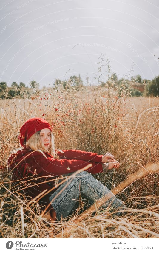 Young woman in a field in a sunny day wearing red clothes Senses Calm Summer Human being Feminine Youth (Young adults) Woman Adults 1 18 - 30 years Nature
