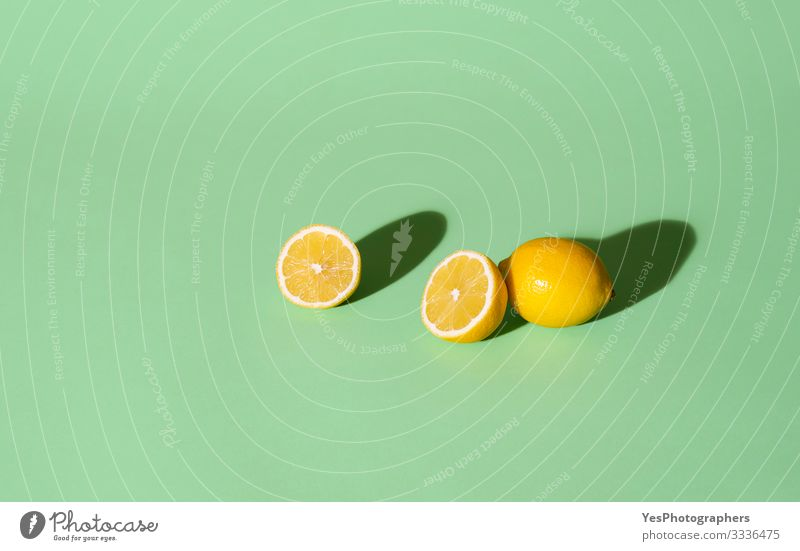 Fresh lemons cut in half on a green background. Summer fruits Fruit Beautiful weather aqua menthe cheerful Citrus fruits colorful fresh fruits fruits background