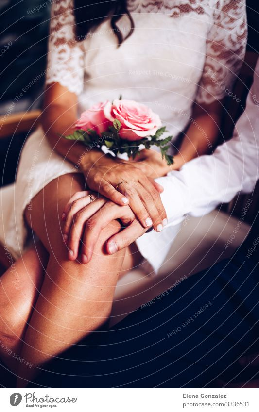 Newlywed couple with their wedding rings. Feasts & Celebrations Wedding Hand Fingers Bouquet Love Together Emotions Trust Romance Eternity Colour Arrangement