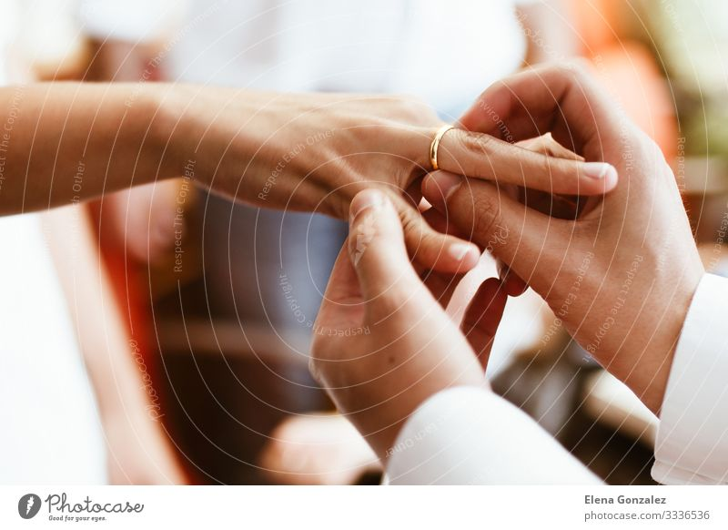 Man putting wedding ring on woman finger. Feasts & Celebrations Wedding Woman Adults Hand Fingers Love Together Emotions Trust Relationship Eternity Future