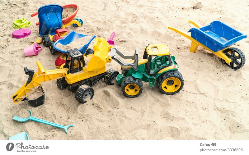 Colourful toys in the sand Joy Summer Beach Kindergarten Child Nature Sand Yellow Background picture Excavator toys for children Sandpit Infancy out variegated