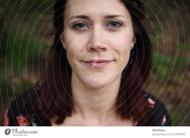 Portrait of a young woman with a subtle smile Lifestyle Joy already Well-being Young woman Youth (Young adults) Face 18 - 30 years Adults Beautiful weather