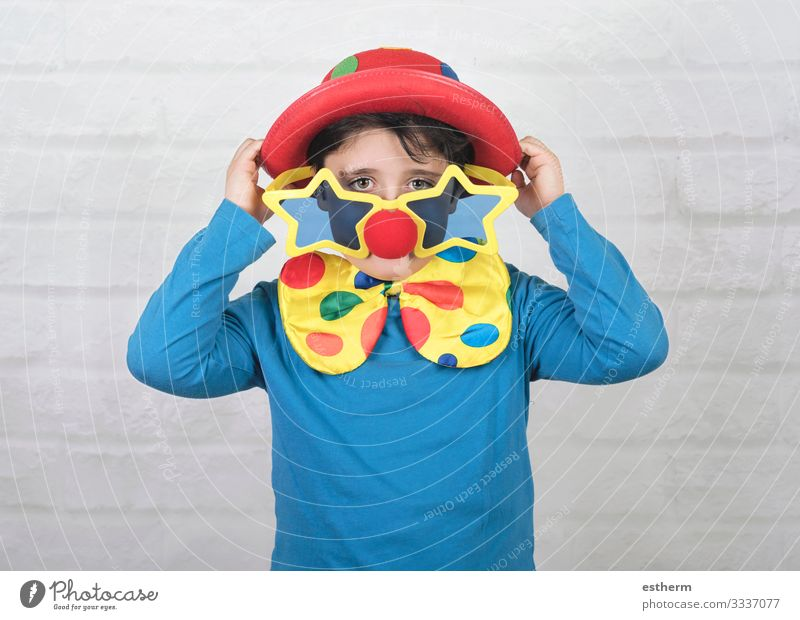 child with clown nose and funny glasses Lifestyle Playing Party Feasts & Celebrations Carnival Hallowe'en Birthday Human being Masculine Child Boy (child)
