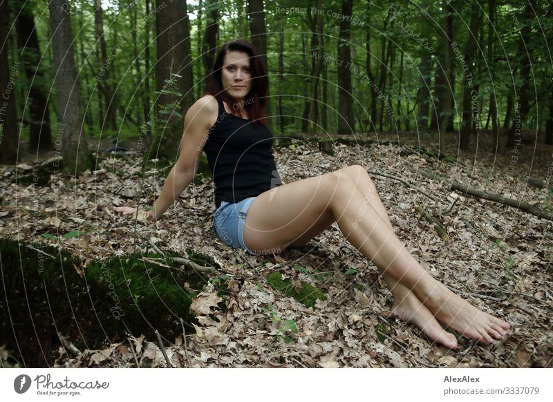 Young woman sitting in the forest Joy Beautiful Life Trip Youth (Young adults) Legs 18 - 30 years Adults Landscape Plant Summer Beautiful weather Leaf Forest
