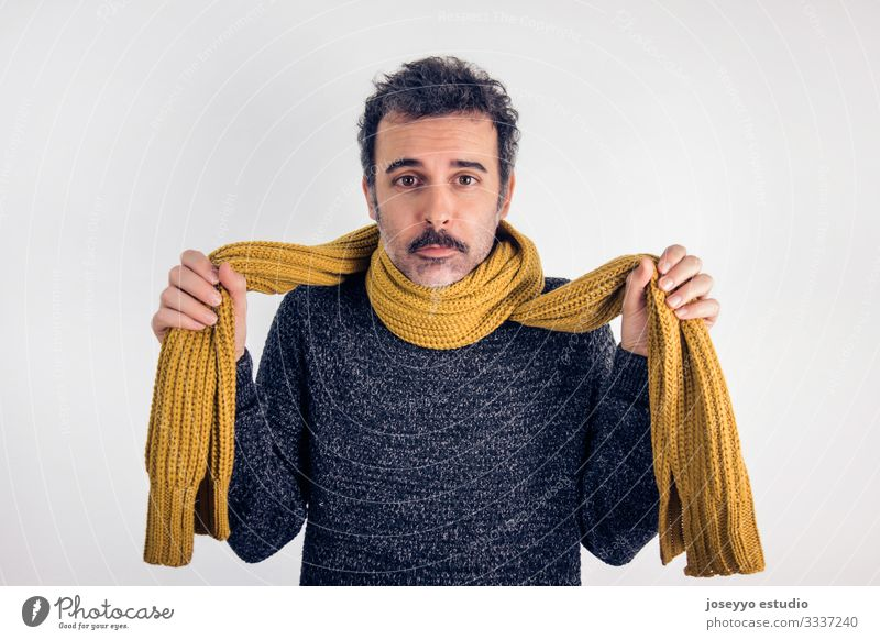 Sad, brunette man with mustache, gray jersey and yellow scarf. Sore throat adult brown care caucasian cold disease expression face fever flu hand headache