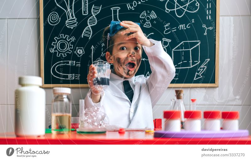 Funny boy chemist with dirty face Playing Science & Research Child School Blackboard Laboratory Human being Boy (child) Man Adults Tie Smiling Smart Disaster