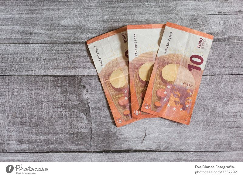 Three euro ten bill. Euro bank notes on grey wood background. Money concept wealth Stack Income wages salary Numbers Sell earnings Accumulation
