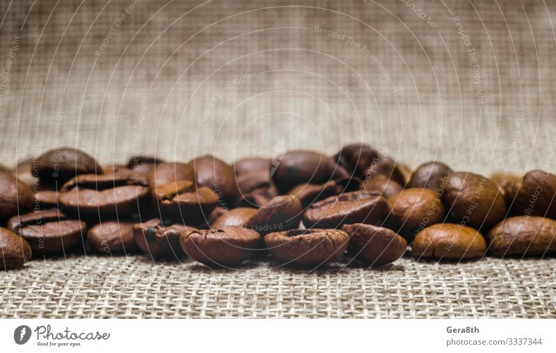 many coffee beans on a matting macro Breakfast Coffee Cloth Dark Fresh Natural Brown Black Energy Colour Aromatic backdrop background Beans Beige blur blurry