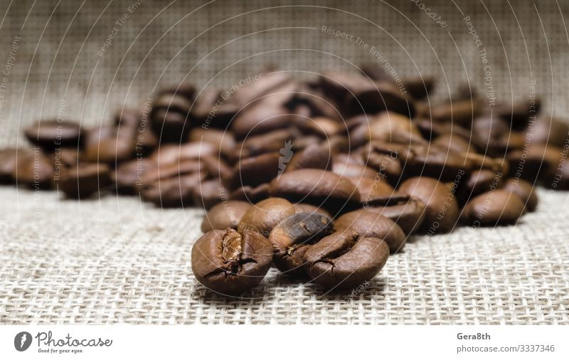 heap of roasted coffee beans on a matting macro Breakfast Coffee Cloth Dark Fresh Natural Brown Black Energy Colour Aromatic backdrop background Beans Beige