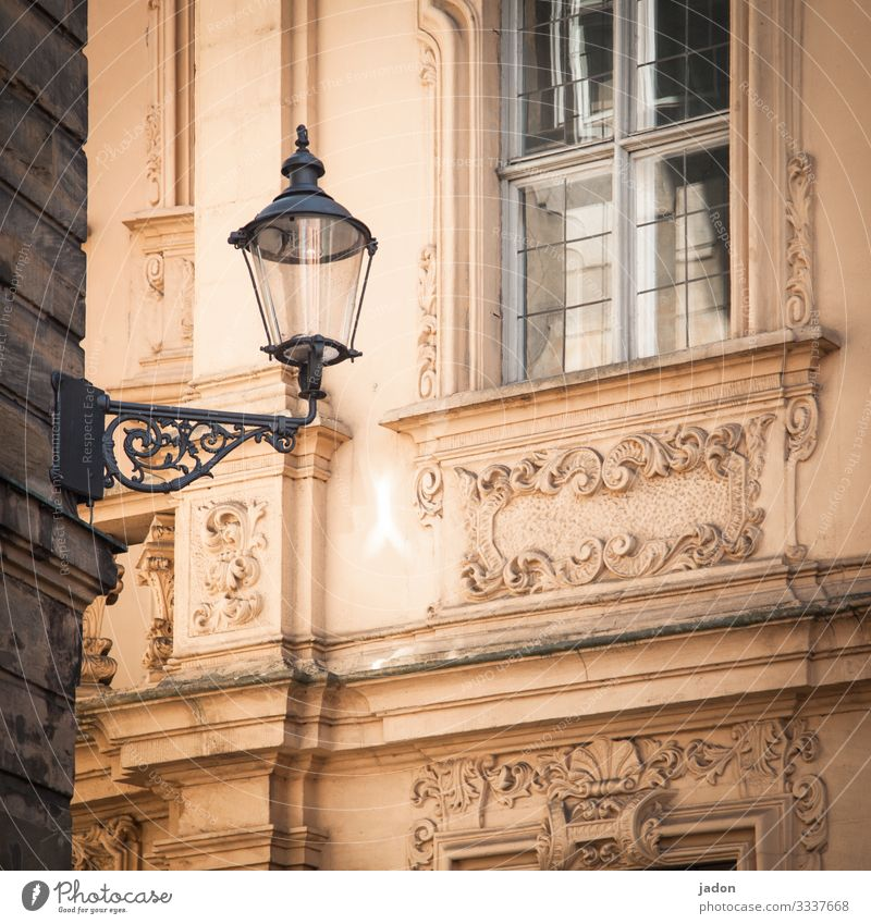 window (closed). light (off). facade (chic). house corner (square). Lantern Light Lamp Street Street lighting Facade Stucco Window Historic Old Square