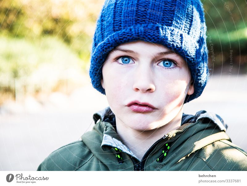 blue cap, blue eyes Cool Cool (slang) Sunlight Intensive portrait Contrast Light Day Lips Mouth Face Nose Eyes Infancy Head Family & Relations Boy (child) Child