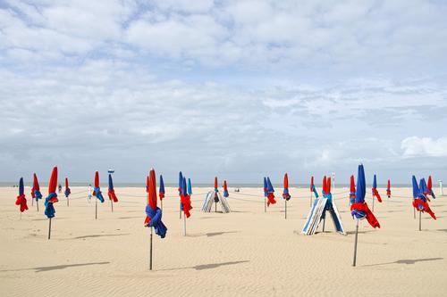 red and blue Relaxation Vacation & Travel Tourism Summer Summer vacation Sun Sunbathing Beach Ocean Sunshade Beautiful weather Coast Normandie Deauville