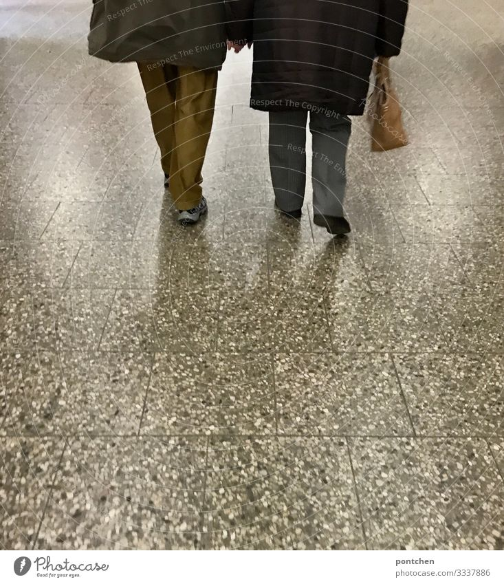 Love-Two seniors walk hand in hand over ground Human being Masculine Feminine Female senior Woman Male senior Man Partner Senior citizen 2 60 years and older