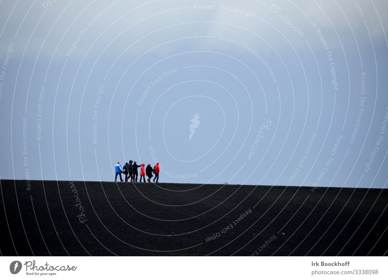 Group of people walking on the dike Ocean Hiking Friendship Sky Wind North Sea Walking Blue Black Safety (feeling of) Loneliness Attachment Colour photo