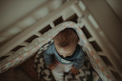 Baby in crib Lifestyle Human being Child Toddler 1 0 - 12 months Lie Sit Cute Above Original Safety Protection Together Peaceful Beginning Contentment