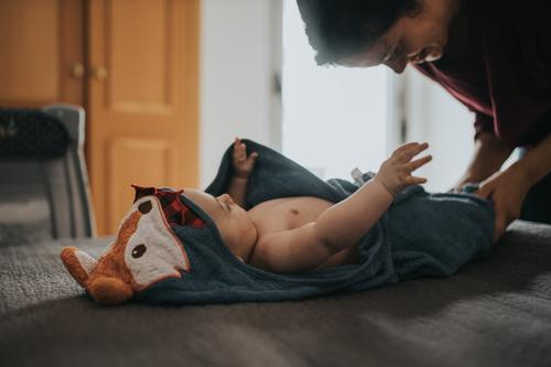 Mother dressing baby after bath motherhood babyhood Baby Dress Dressing Caucasian Home Lifestyle Love Woman Parents Family & Relations Beautiful Happy care