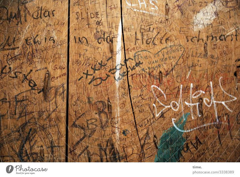 Perpetuations | Written Wood grain Crack & Rip & Tear Felt-tipped pen Sign Characters Digits and numbers Signs and labeling Graffiti Endurance Anger Aggravation
