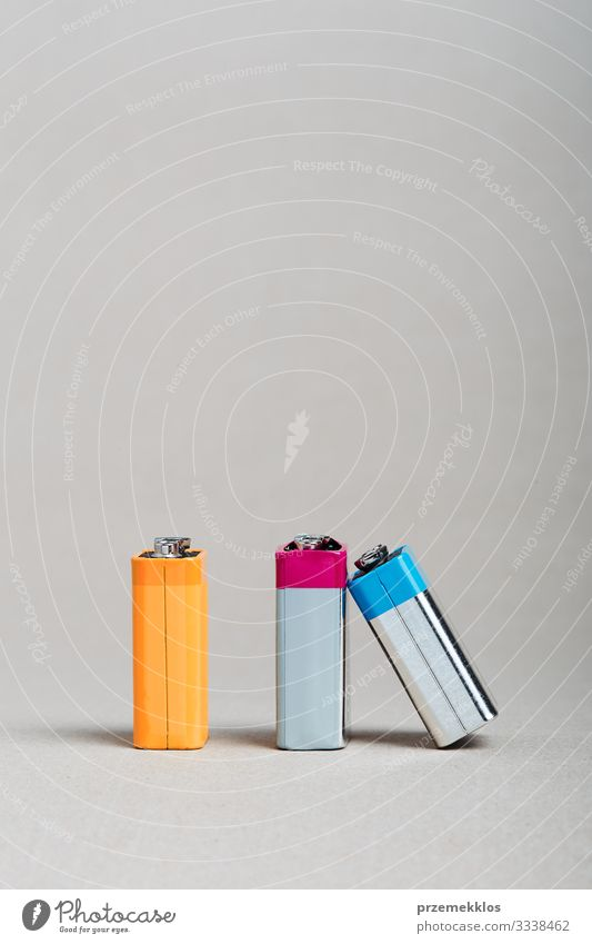 Used battery leanted on another battery like a domino piece Environment Old Green Energy Considerate Environmental pollution Environmental protection Change