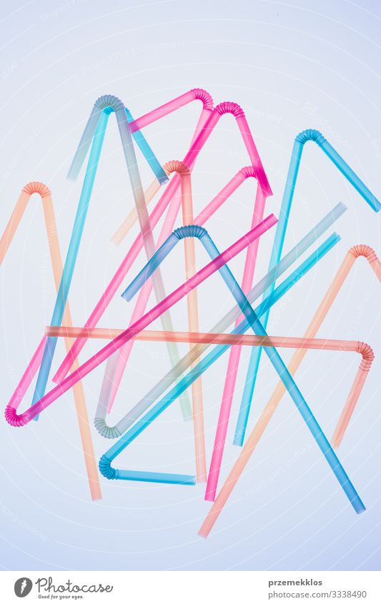 Colorful plastic straws scattered over blue background Beverage Environment Plastic Colour Environmental pollution Environmental protection drink Cocktail Trash