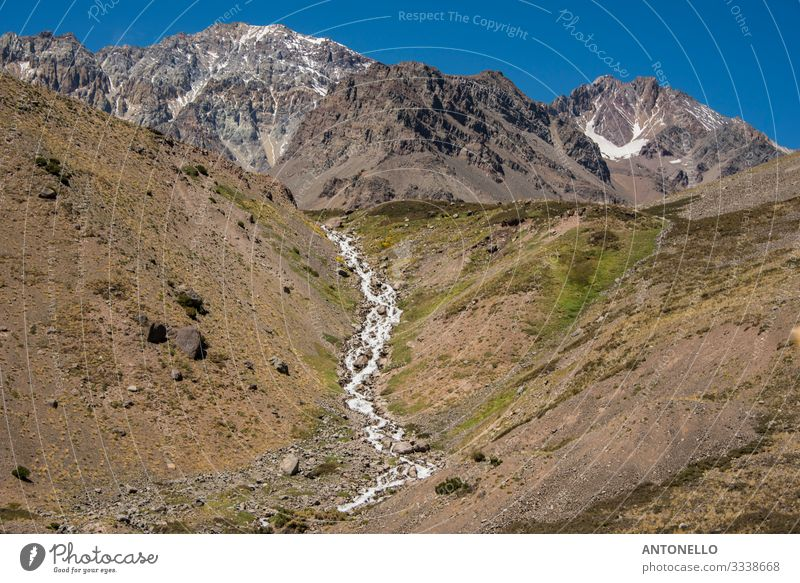 Andean mountain landscape with stream Environment Nature Landscape Earth Sky Summer Climate change Snow Hill Rock Mountain Andes the cordillera of the andes