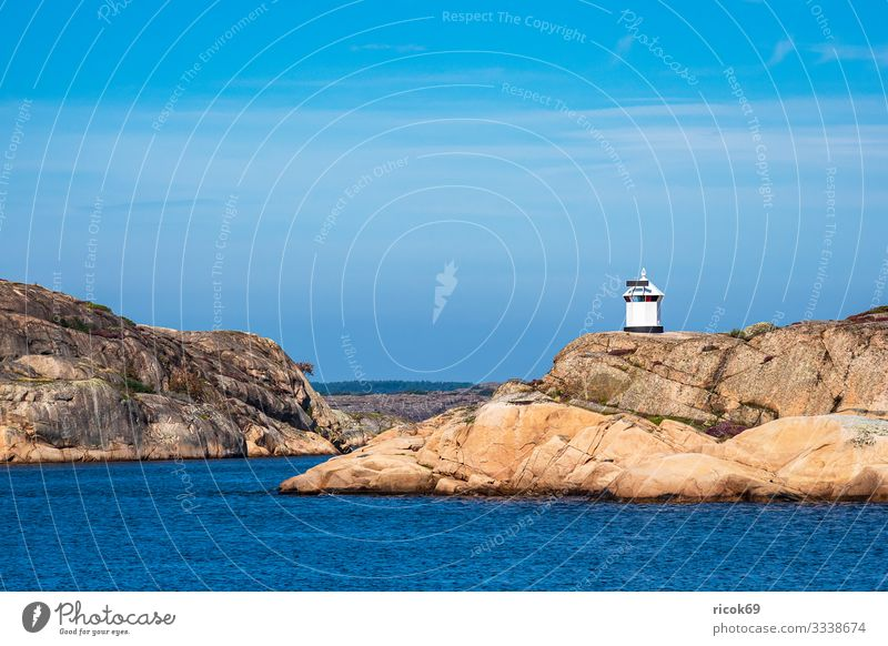Lighthouse near the town of Fjällbacka in Sweden Vacation & Travel Tourism Summer Ocean Island Nature Landscape Water Rock Coast North Sea Architecture