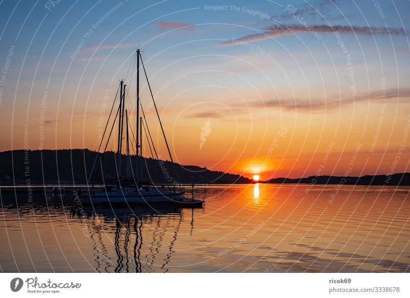 Sunset in the town of Fjällbacka in Sweden Vacation & Travel Tourism Summer Ocean Island Nature Landscape Water Clouds Coast North Sea Harbour