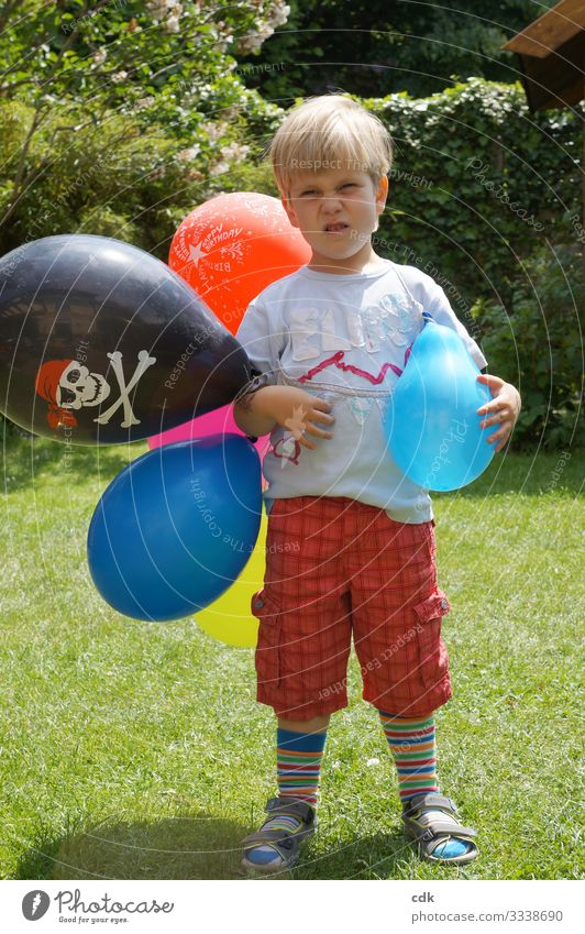 In the best party mood. Child Boy (child) Nursery school child Infancy balloons Summer Hull nose Garden celebrations Bad mood unwilling critical