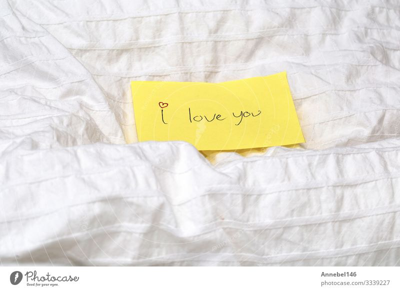 Handwritten little yellow note with the words I love you Happy Beautiful Make-up Table Feasts & Celebrations Valentine's Day Woman Adults Paper Heart Kissing
