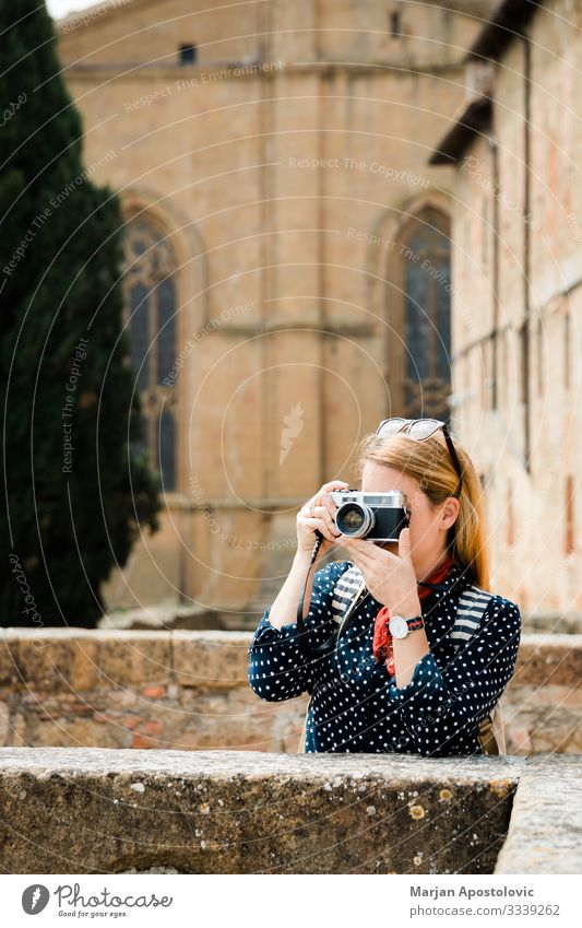 Young woman taking a photo in an old town in Italy Lifestyle Vacation & Travel Tourism Trip Sightseeing Camera Human being Feminine Youth (Young adults) Woman