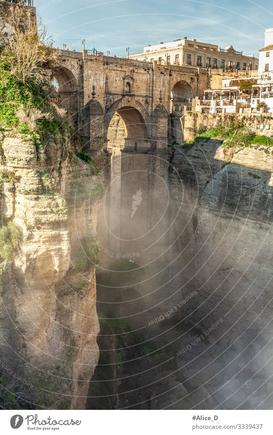 Ronda El Puente Nuevo and El Tajo Gorge Vacation & Travel Sightseeing City trip Fog Rock Canyon Spain Europe Town Old town Bridge Manmade structures