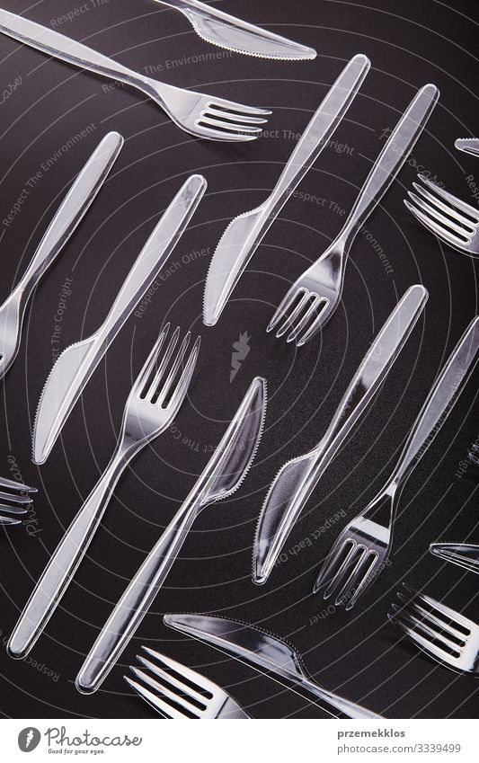 Plastic cutlery scattered over red background Cutlery Fork Save Environment Container Red Environmental pollution Trash garbage recycle Recycling Ecological