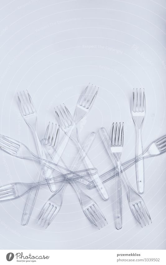 Plastic forks scattered over white background Cutlery Fork Save Environment Container Crystal Blue White Environmental pollution Trash garbage recycle Recycling