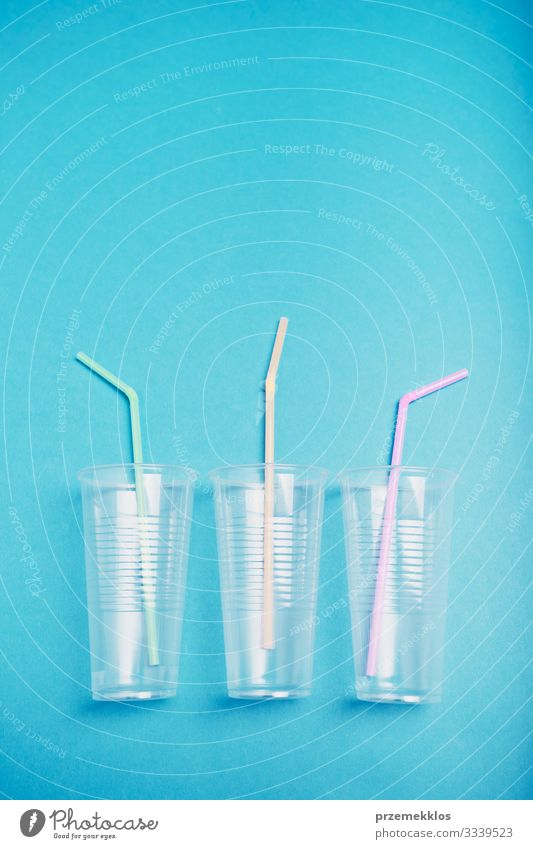Empty plastic cups with colorful straws Blue Environment Copy Space Plastic Trash Environmental protection Ecological Conceptual design Household Save