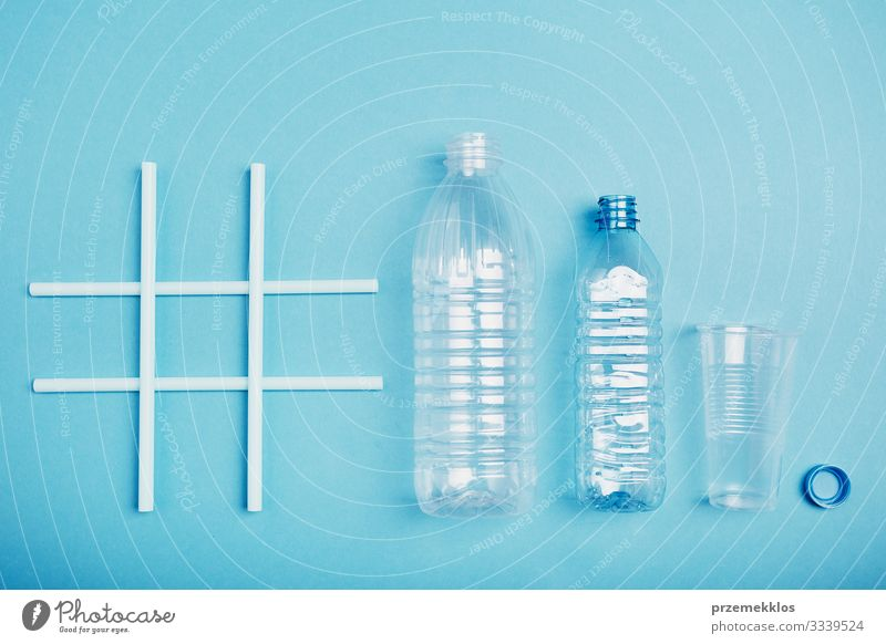 Hashtag recycling. Empty plastic bottles, cup and bottle cap Blue Environment Copy Space Plastic Trash Environmental protection Bottle Ecological
