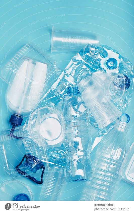 Squashed empty plastic waste collected to recycling Blue Environment Copy Space Future Change Plastic Decline Trash Environmental protection Bottle Packaging